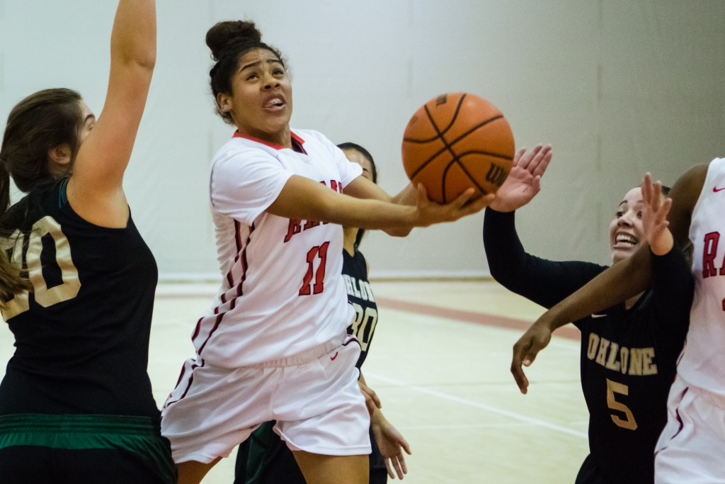 City College freshman guard Gabrielle Vigil (11) drives toward the net against the Ohlone College Renegades on Jan. 20, 2016. (Photo by Peter Wong/Special to The Guardsman)