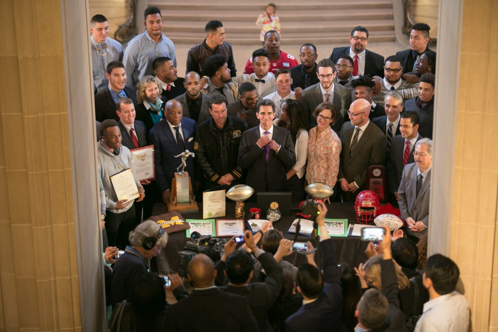 The Rams football team pose for a picture with San Francisco Mayor Ed Lee, Mark Leno, Willie Brown and other officials after being honored for their national champion football program on Feb. 5, 2016. (Photo by Santiago Mejia/The Guardsman)