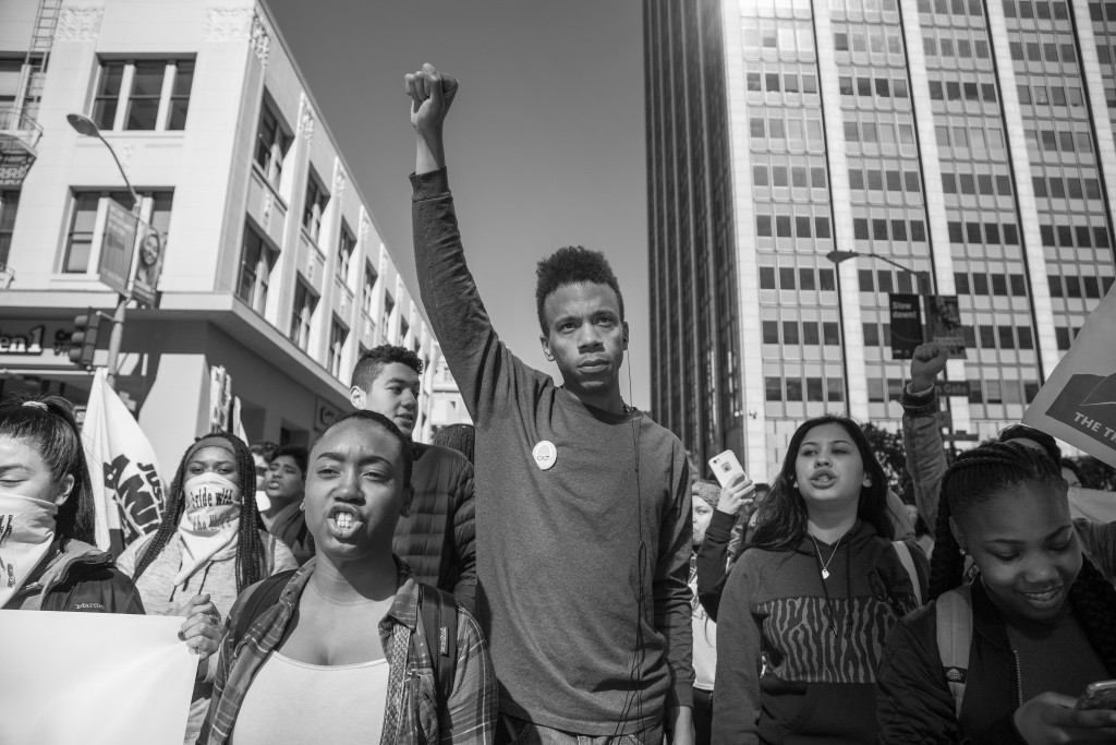 City College student Adam Coleman demands justice for Alex Nieto outside the Phillip Burton Federal building on Tues. March 1, 2016. (Photo by Gabriella Angotti-Jones / The Guardsman)