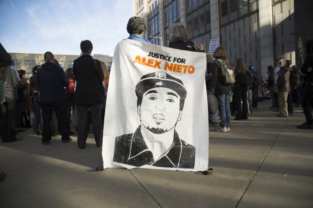 Supporters listen to a rally speaker at the at the Justice for Alex Nieto Walkout on Tues. March 1, 2016. (Gabriella Angotti-Jones / The Guradsman)March 1, 2016.