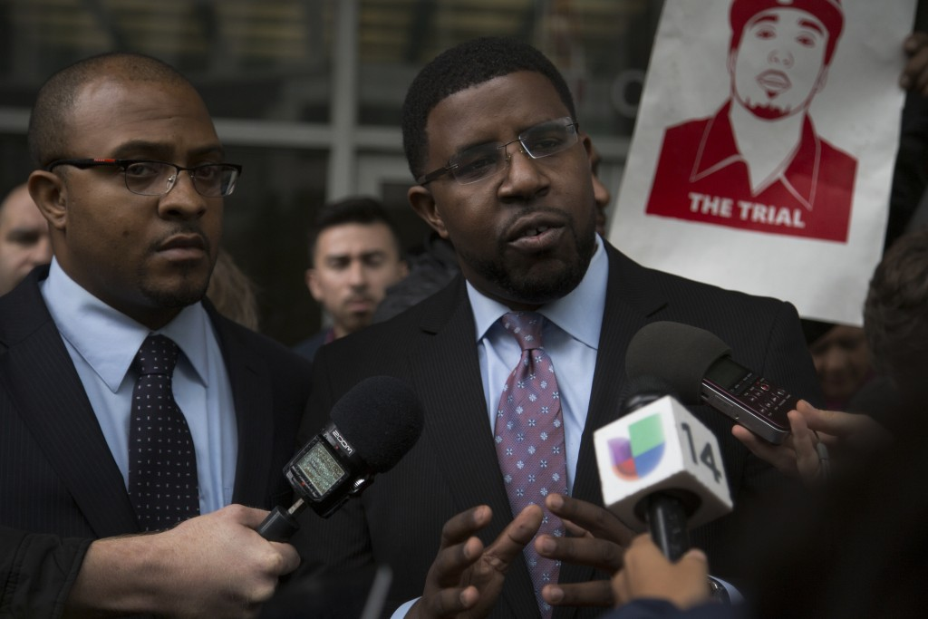Nieto family attorneys Lateef Grey (left), and Adante Pointer (right), speak on the trial ruling at the Federal Court building on March 10, 2016. (Photo by Gabriella Angotti-Jones / The Guardsman)