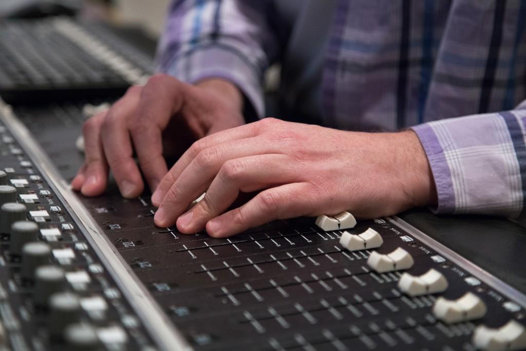 "Rapper Scott ""S-Class"" Samels prepares his track ""Corporatocracy"" for his debut solo album in the Art Extension studio B on Tuesday. (Gabriella Angotti-Jones/ The Guardsman)"