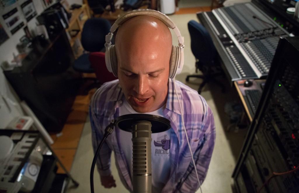 "Rapper Scott ""S Class"" Samels raps over his track ""Corporatocracy"" for his debut solo album in the Arts Extension studio B building on Tuesday. (Gabriella Angotti-Jones/The Guardsman)"