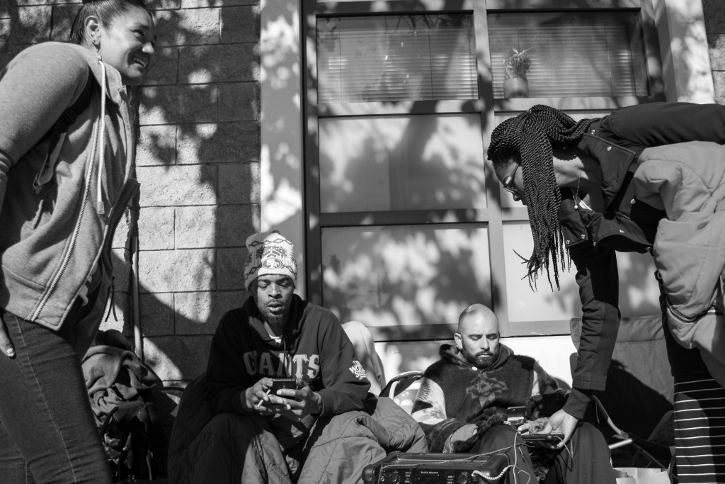 From left to right: Catherine Marroquin, Sellassie, Edwin Lindo and Estell Williams camp out in front of the Mission Police Station during day five of a hunger strike demanding that Mayor Ed Lee and SFPD Police Chief Greg Suhr resign from their positions in San Francisco on April 25, 2016. (Photo by Joel Angel Juarez/Special to The Guardsman)