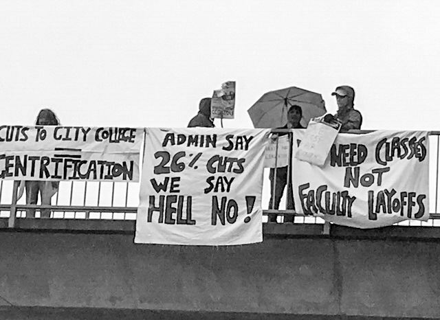 AFT 2121 members hang banners over the Muni overpass on Ocean avenue on April 27, 2016. (Photo by Danya Aispuro/Special to The Guardsman)participate in a one day strike in front of the Ocean  campus on April 27, 2016. Photo by Danya Aispuro/Special to The Guardsman