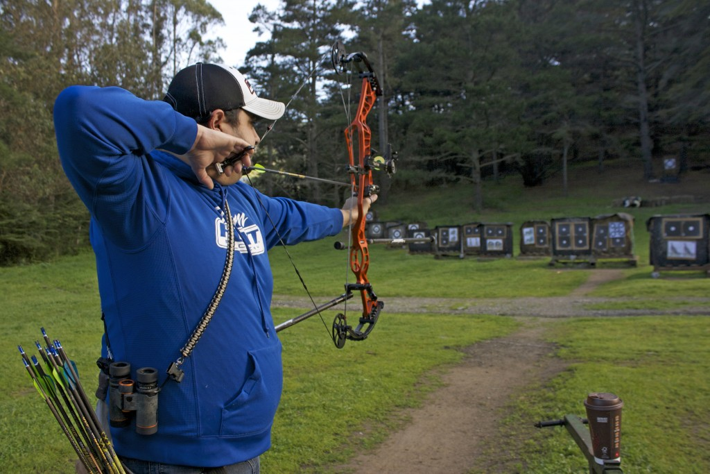 Rudy Sandoval Jr. aims for the target at the San Francisco Archery Range in Pacifica on March 25, 2016. (Photo by Cassie Ordonio/ The Guardsman)