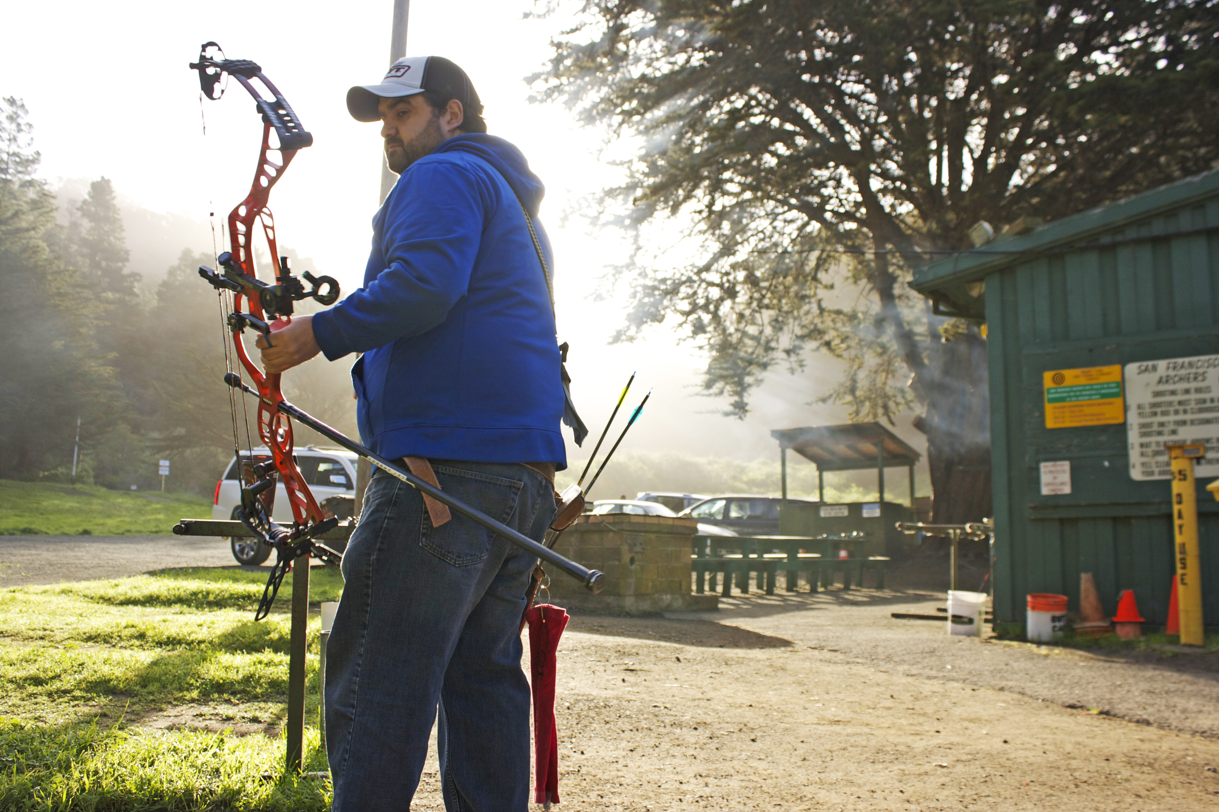 Rudy Sandoval Jr. stands in the morning sunlight as he prepares to begin target practice on March 25, 2016. Sandoval trains everyday at the San Francisco Archery Range in Pacifica. (Photo by Cassie Ordonio/The Guardsman)