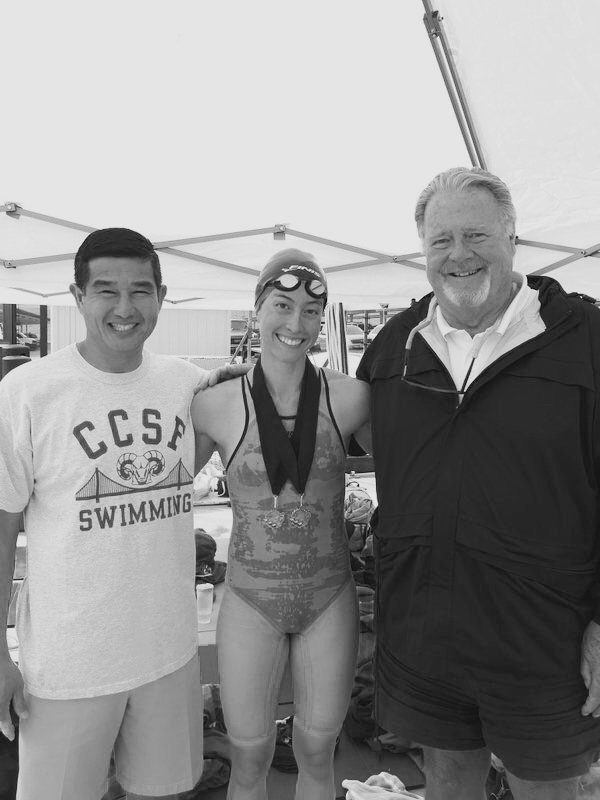 City College swim coaches Phong Pham (left) and Jim Cunningham (right) pose with Danielle Pea following her first place finish in the 50 and 100-yard swim events on April 22, 2016.