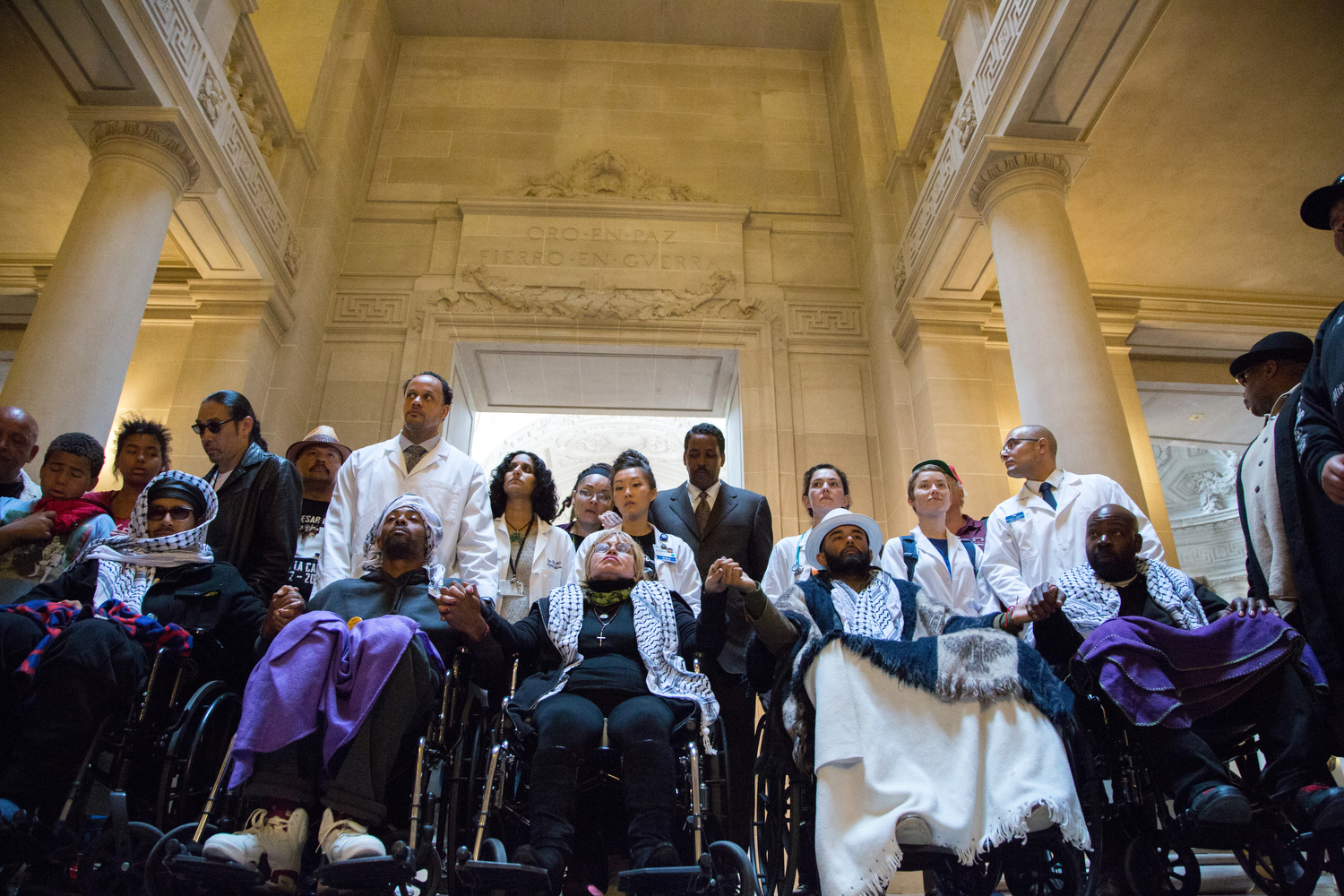 "The ""Frisco 5"" hunger strikers (from left in wheelchairs) Ilych Sato, Sellassie Blackwell, Maria Cristina Gutierrez, age 66, Edwin Lindo and Ike Pinkston take a moment at City Hall before demanding to meet with Mayor Ed Lee in protest against alleged police brutality. (Santiago Mejia / The Guardsman)"