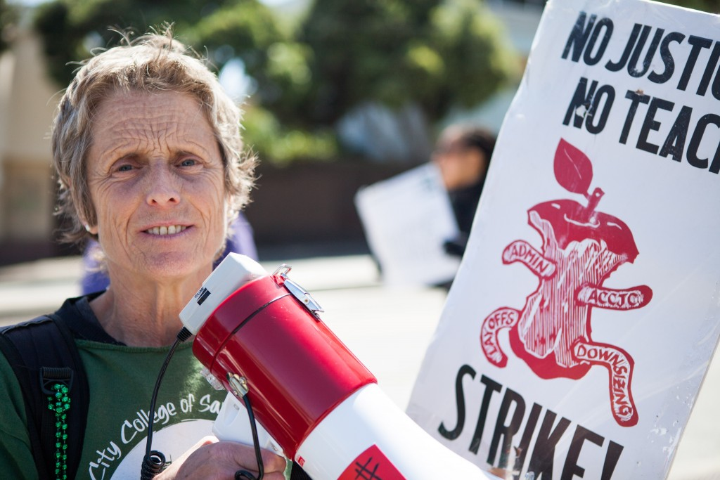 AFT 2121 member Kathe Burick helps lead City College faculty sing and chant while picketing against unfair labor practices at Ocean Campus on April 27, 2016. (Photo by Natasha Dangond/Special to