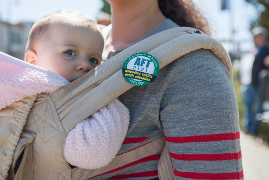 City College English instructor Mitra Sapienza, with her daughter Colette, during a strike against unfair labor practices at Ocean Campus on April 27, 2016. (Photo by Natasha Dangond/Special to The Guardsman)on Wednesday, April 27, 2016. City College of San Francisco Ocean Campus.