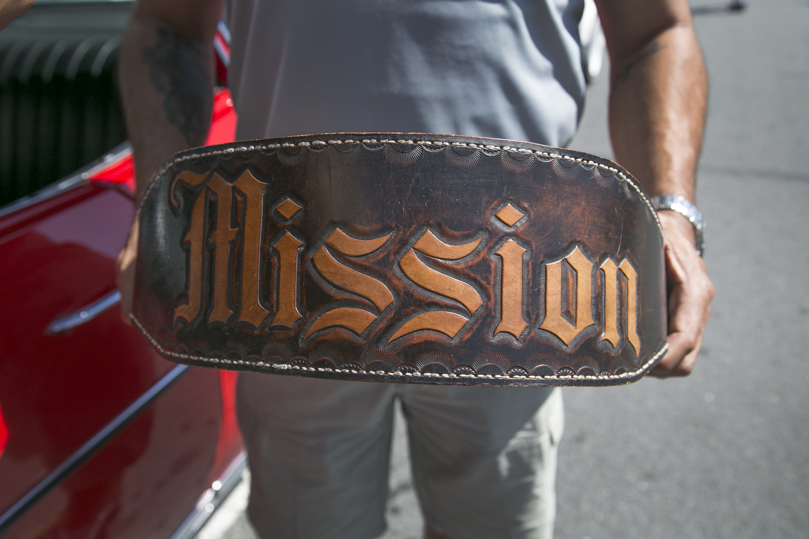 City College English professor Benjamin Bac Sierra holds his brother's etched-weight belt from his time in prison during the 1980s. His brother graduated from City College and encouraged Bac Sierra to enroll. Bac Sierra bought his first lowrider car when he received tenure at City College. (All photos by Gabriella Angotti-Jones/The Guardsman)Jones).