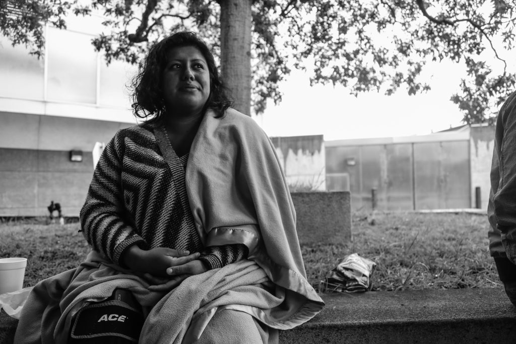 City College Criminal Justice student, Yesenia Cielo, sits with a blanket wrapped around her after being released from county jail. (Photo taken by Natasha Dangond/ Special to The Guardsman)