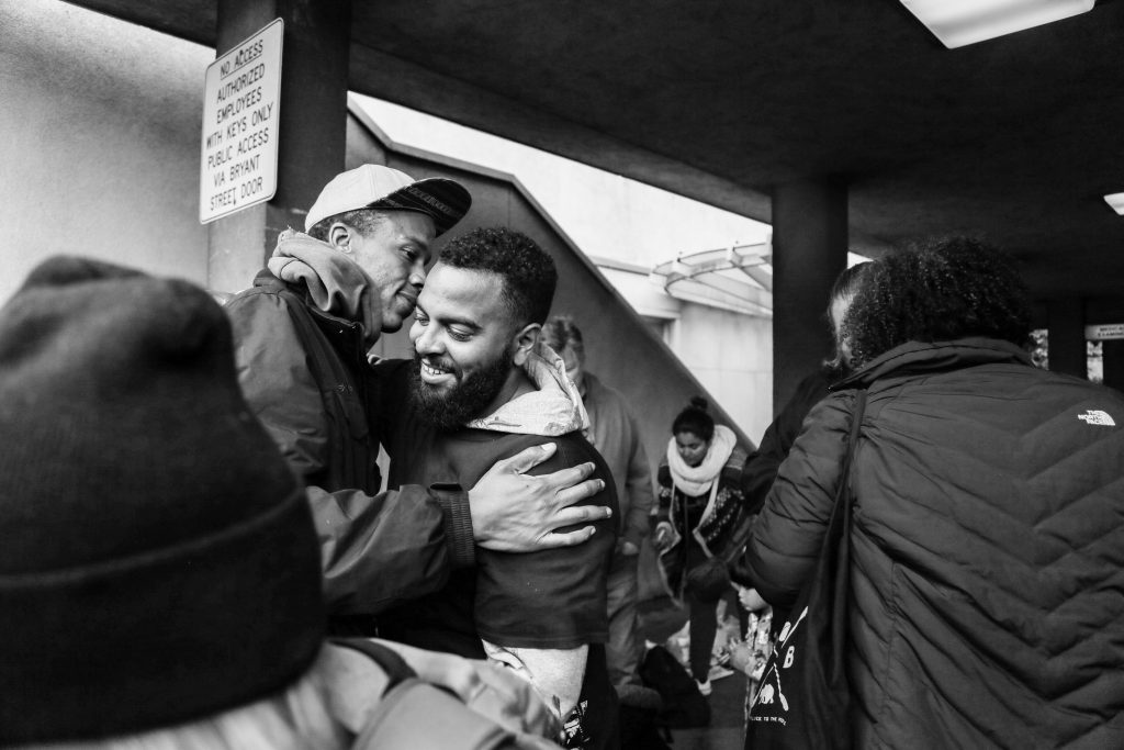 James Burch, left, and Christopher Rudd, right, embrace after being arrested during a rally against alleged police brutality on May 6, 2016. They reunite outside the San Francisco County Jail at 850 Bryant St. on May 7, 2016. (All Photos by Natasha Dangond/Special to The Guardsman)