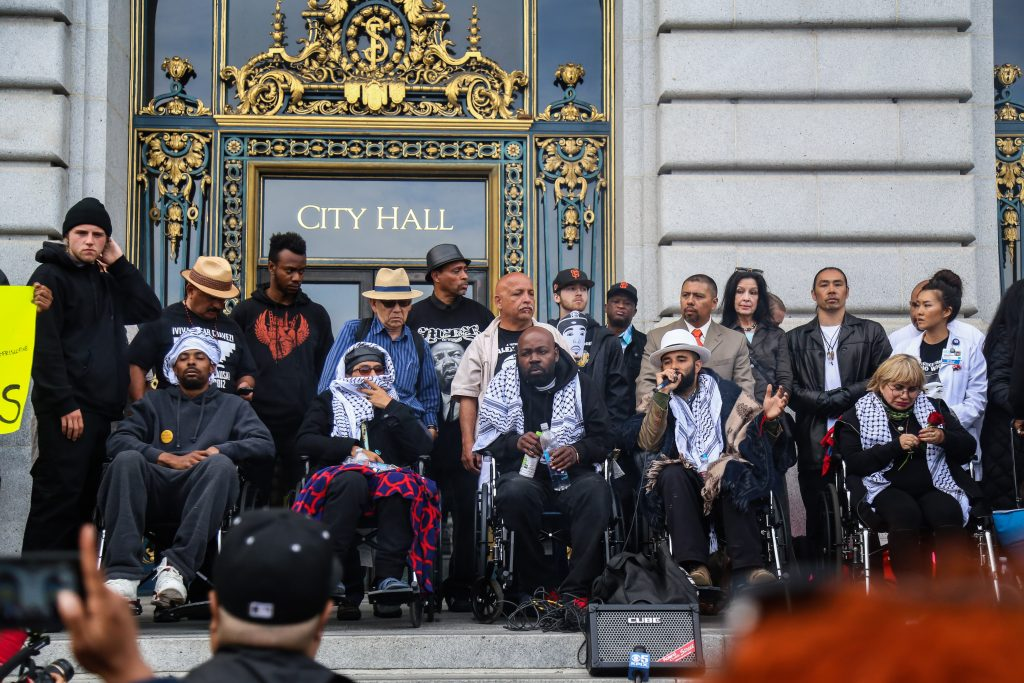 (From L to R ) Sellassie, Equipto, Pinkston, Lindo, and Gutierrez, also known as the 'Frisco Five' hold a meeting in front of City Hall after marching into the building with hundreds of protestors, rallying against police brutality on Tues. May 3, 2016, (Photo by Natasha Dangond/Special to The Guardsman)