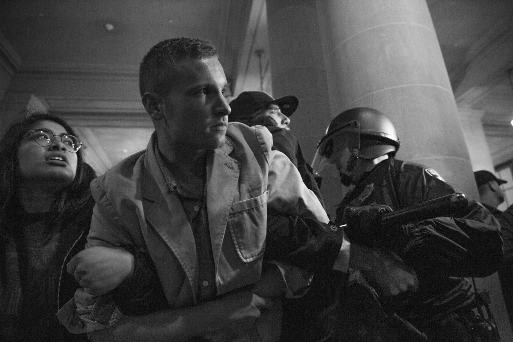 A protester is arrested during a Hunger for Justice SF occupation of City Hall last night. 33 people were arrested. Protesters demanded action against police brutality and for SFPD Chief Suhr to be fired. (Photo by Gabriella Angotti-Jones).