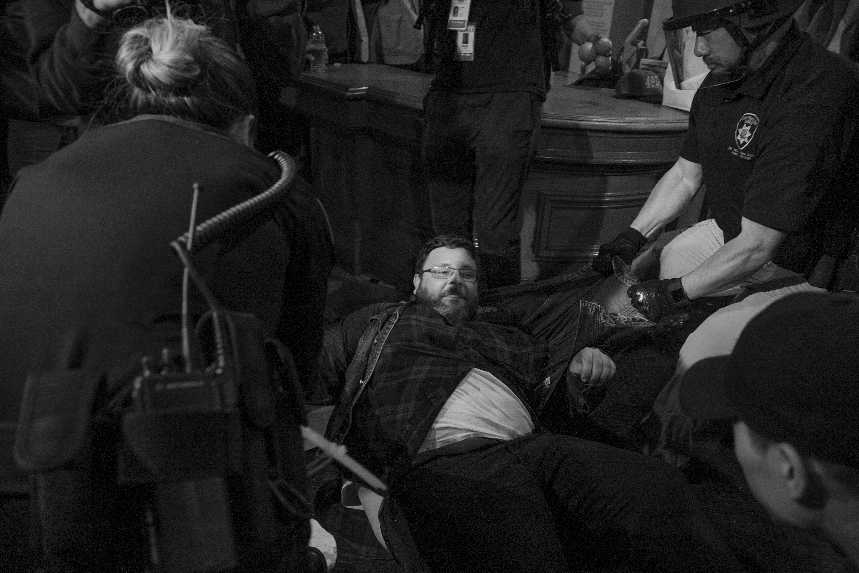 A protester is arrested and dragged across the floor during a Hunger for Justice SF after hours occupation of City Hall last night. 33 people were arrested. Protesters demanded action against police brutality and for SFPD Chief Suhr to be fired. (Photo by Gabriella Angotti-Jones)
