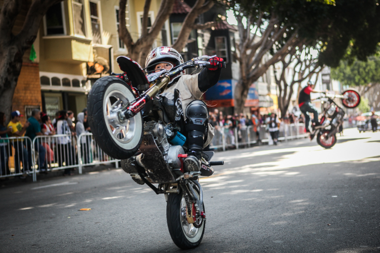 The 8-year-old stunt rider, AJ Stuntz performs tricks and stunts during the 38th Annual Carnaval San Francisco grand parade on 24th Street in San Francisco's Mission District, Sunday, May 29, 2016. (Photo by Ekevara Kitpowsong)