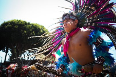 Aztec dancer performs in the 38th Annual Carnaval San Francisco grand parade on 24th Street in San Francisco's Mission District during Memorial Day weekend, Sunday, May 29, 2016. (Photo by Ekevara Kitpowsong)
