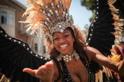 Carnaval performer in costume marches in the 38th Annual Carnaval San Francisco grand parade on 24th Street in San Francisco's Mission District during Memorial Day weekend, Sunday, May 29, 2016. (Photo by Ekevara Kitpowsong)