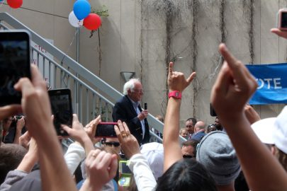 -Senator Bernie Sanders smiles as supporters applaud his arrival at City College's Mission center on Monday, June 6, 2016. (Photo by Audrey Garces/The Guardsman)