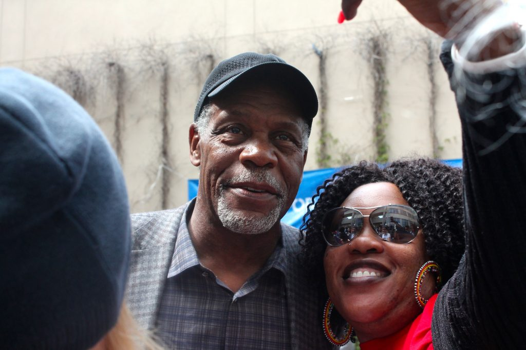 Danny Glover, actor and avid Sanders supporter, takes photos with a crowd of fans after the canvassing kick-off on Monday, June 6, 2016. (Photo by Audrey Garces/The Guardsman)