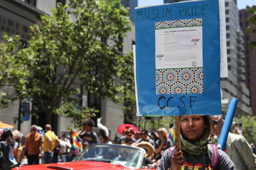 City College professor of Middle East Studies Neela Chatterjee holds a sign that reads Muslim Pride at the San Francisco Pride Parade on June 26, 2016. (Photo by Cassie Ordonio/The Guardsman)