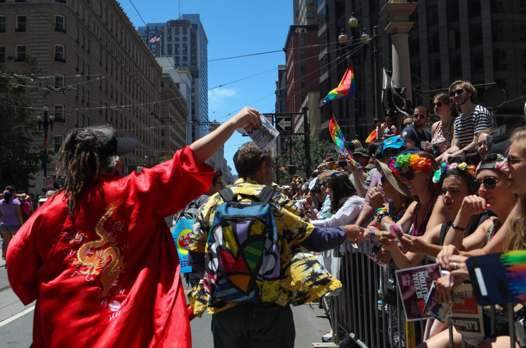 City College faculty hand out flyers to the crowd along the parade route in attempt to recruit future students during the San Francisco Pride Parade on June 26, 2016. (Photo by Cassie Ordonio/The Guardsman)