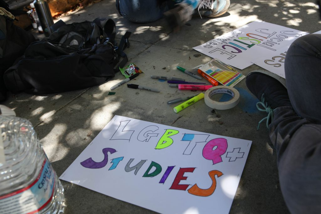 City College faculty create signs before the San Francisco Pride Parade to support the Interdisciplinary Studies program on June 26, 2016. (Photo by Cassie Ordonio/The Guardsman)
