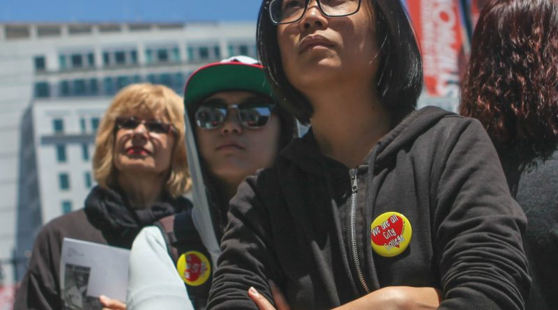 Jenny Huang (right), Deanne Liu (middle) and Tina Martin (left) listening to City College graduate Tony Robles's speech during the rally outside of San Francisco's City Hall on June 29, 2016. (Photo by Cassie Ordonio/The Guardsman)