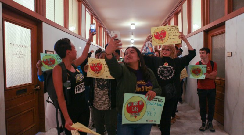 Student supporters Snapchat during their march with AFT members through the Board of Supervisors corridors in San Francisco City Hall on July 12, 2016.