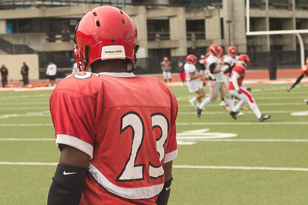Sophomore defensive back Vince Camp looks on as teammates run drills at George Rush Stadium on Aug. 17, 2016 (Photo by Izar Decleto/The Guardsman)