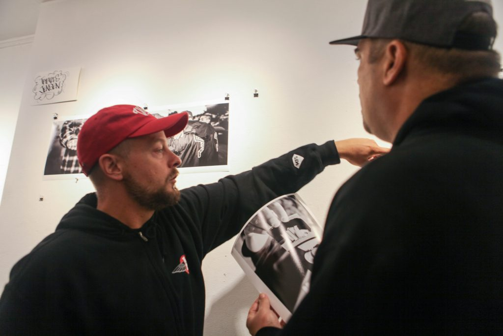 Photographer Travis Jensen promotes his artwork at Book and job Art Gallery on Aug. 5, 2016 (Photo by Cassie Ordonio/The Guardsman)