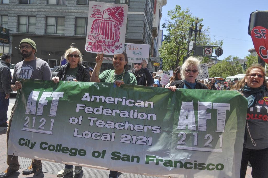 AFT members, teachers, students and protesters marching down Market Street towards the Civic Center campus of City College of San Francisco as part of the strike on April 27, 2016. (Photo by Bridgid Skiba/The Guardsman)