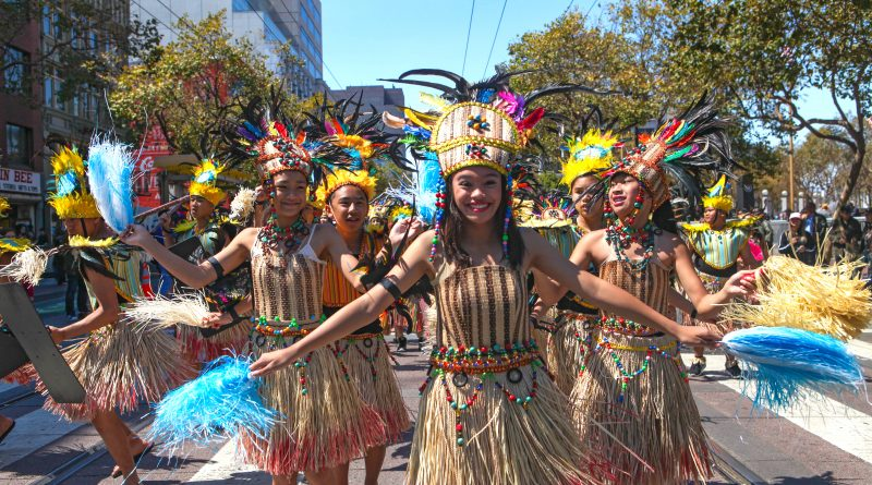 A group of young women and men dance together in the Pistahan Parade down San Francisco's Market Street (Photo by Cassie Ordonio/The Guardsman)