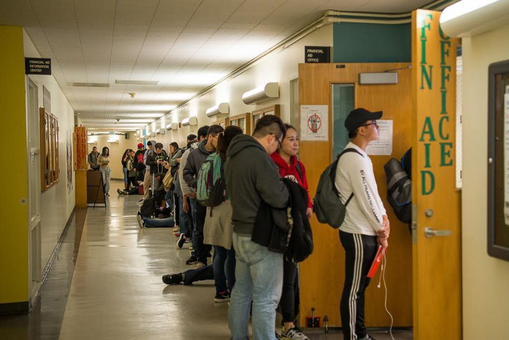 City College students wait in line for the financial aid office in Conlan Hall August 17, 2016. (Photo by Izar Decleto / The Guardsman).