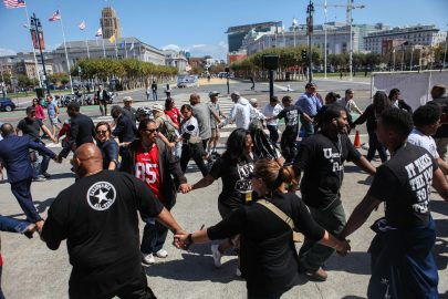 Demonstrators join indigenous dancers in front of San Francisco's City Hall in support of a memorial resolution for Alex Nieto on September 13, 2016. (Photo by Cassie Ordonio/ The Guardsman