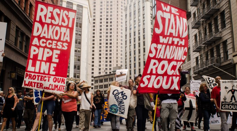 """Supporters of the Standing Rock Sioux Tribe march down Kearny Street, in the Financial District Downtown San Francisco chanting """"Water is sacred, you cant drink oil"""" on Sept. 7, 2016. Photo by Gabriela Reni/ The Guardsman.  San Francisco, California. September 7, 2016. (Gabriela Reni/Gabriela Reni / The Guardsman)"""