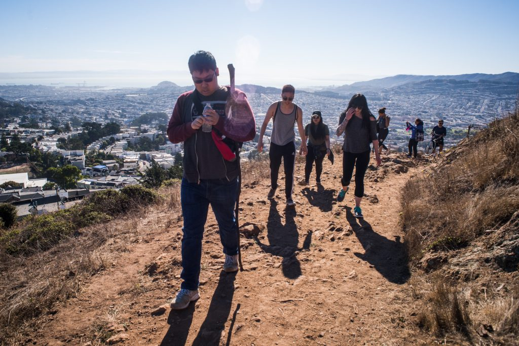 From Left to right: Eason Lin, Elson Law, Toni Rose Babasoro, Cordelia Carlisle, Carla Hovde, Ankita Sethi, Richard Deamicis on their way up Mt. Davidson. San Francisco's Bay in the background on Oct. 8, 2016. Photo by Gabriela Reni/ The Guardsman.