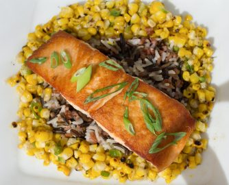 Pan-roasted salmon has hints of lemon balanced with three types of rice and semi-sweet corn salsa (Photo by David Horowitz/The Guardsman)