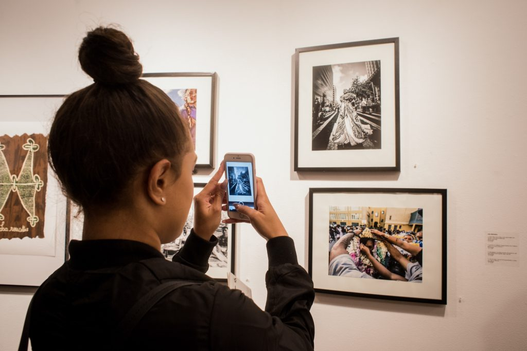 Student documents the event at the Being Pacific opening reception at San Francisco State University on Oct. 13, 2016. Photo by Gabriela Reni/ The Guardsman.