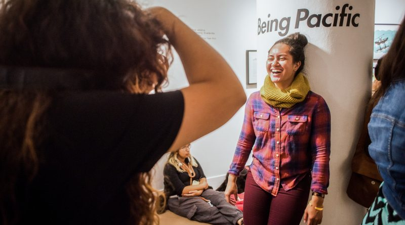 Public take pictures at the Being Pacific opening reception at San Francisco State University on Oct. 13, 2016. Photo by Gabriela Reni/ The Guardsman.