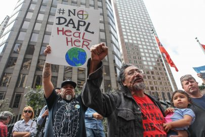 Native American activist William Underbaggage holds his daughter, Chante Tinza Winyan, 16 months old, in the Financial District on Sept/ 8. 2016 in protest against the Dakota Acces Pipeline project. Underbaggage is fighting for clean water for his daughter and for more generations to come. (Photo by Cassie Ordonio/The Guardsman)