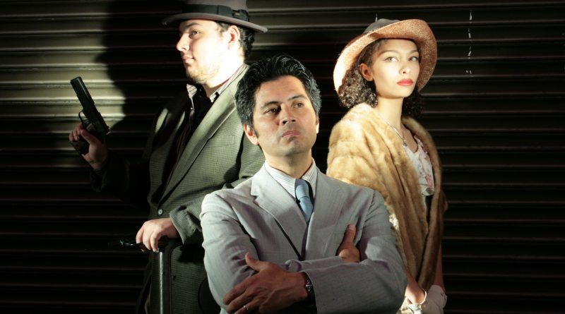 "City College student Raphael Musni, center, plays the lead in ""The Resistible Rise of Arturo Ui"" at the Diego Rivera Theatre. (Photo by Michaela Payne/Special to The Guardsman)"
