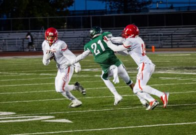Sophomore wide receiver Erik Phillip (L) with assist from sophomore wide receiver Chikwado Nzerem (R) attempts to run in for a touchdown at Laney College. The Rams eventually lost the game to the Eagles with the final score of 18-13 on September 2, 2016.  File photo Gabriela Reni/The Guardsman