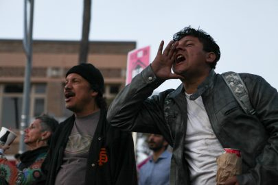 Crowd members shout against evictions and homeless displacement at 24th and Mission St. on Nov. 3, 2016. (Photo by Cassie Ordonio/The Guardsman)