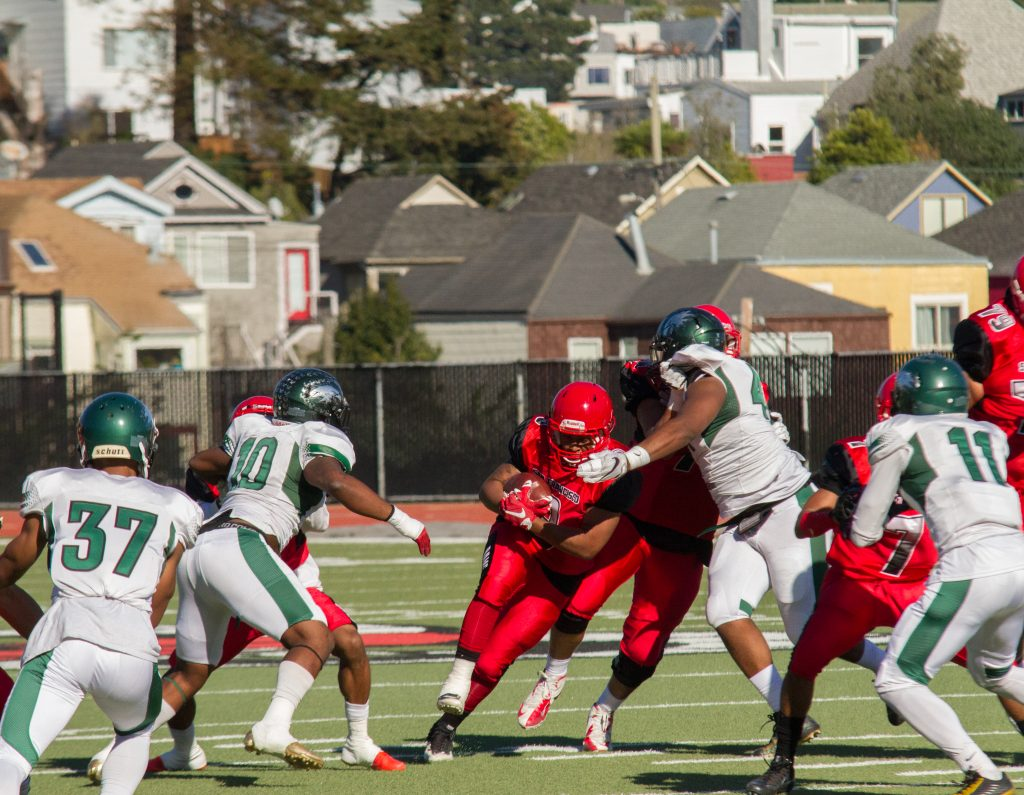 Rams running back Lorenzo Logwood (3) breaks through a tackle during  the San Francisco Community College Bowl at George Rush Staduim on Saturday Deember 3, 2016. Photo by Franchon Smith/The Guardsman