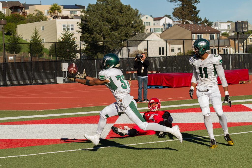 Laney's Ke'Nigil Williams, 37,i (left) intercepts a bobbled pass that was intended for Erik Phillip, 4 (center)  during  the San Francisco Community College Bowl at George Rush Staduim on Saturday Deember 3, 2016. Photo by Franchon Smith/The Guardsman