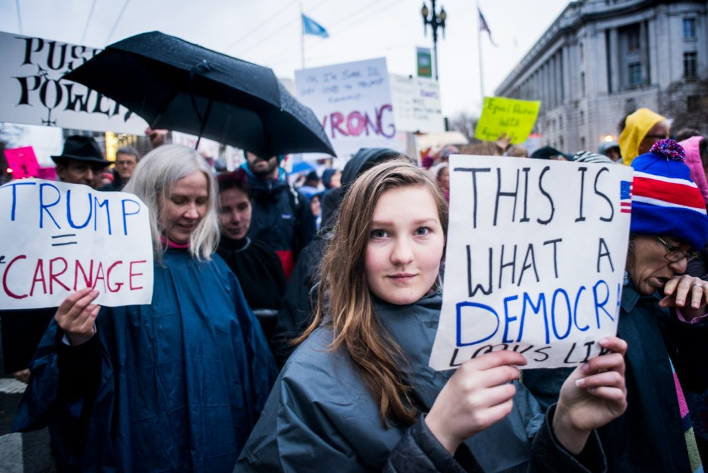 Thousands of people from San Francisco and the Bay Area in support of women of all over the world and in opposition to President Donald Trump's remarks and behavior towards women, march down Market St. on Jan 21st, 2017. San Francisco, CA. Photo by Gabriela Reni/ The Guardsman.