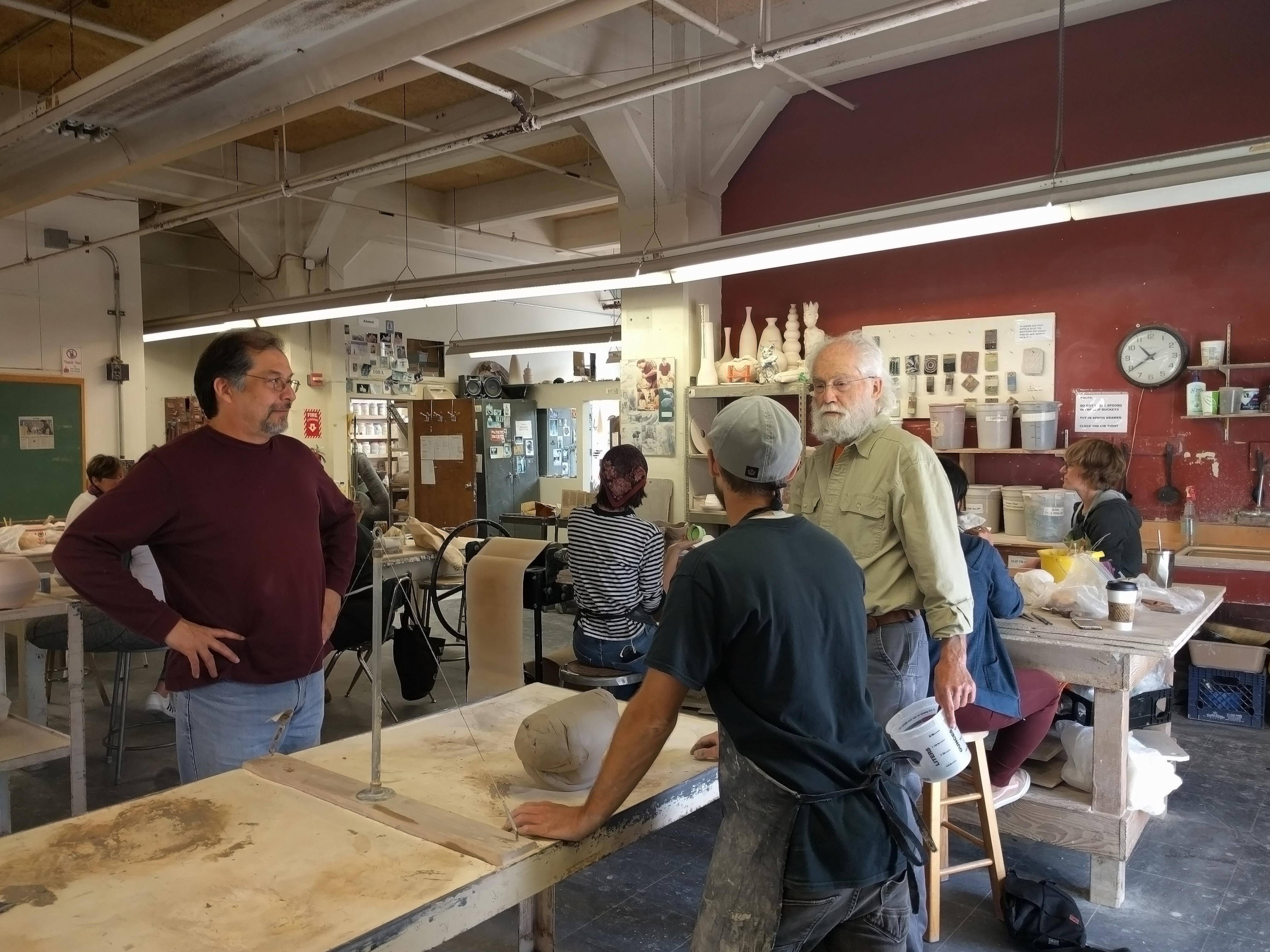 Instructor Olivero Quezada and his assistants instruct students in the spacious Fort Mason ceramics studio. Photo by Elena Stuart/The Guardsman